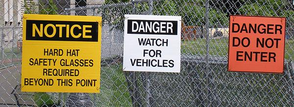 construction signs on fence