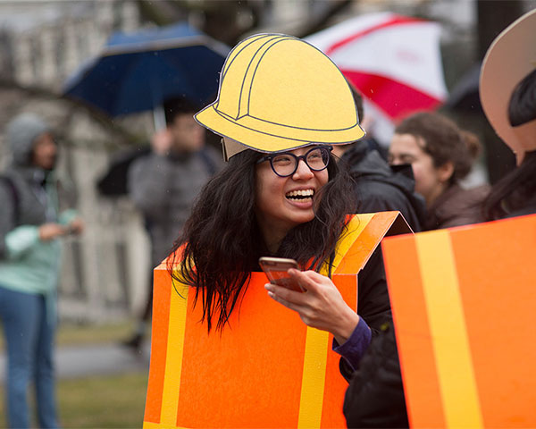 A costumed student dressed as a construction zone